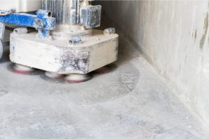Grinding and polishing concrete floor with a big machine