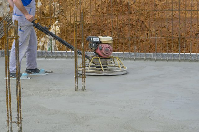 Concrete Polishing Project by a worker with a polisher